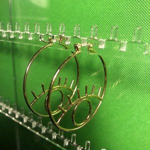 Earrings with eye design.
